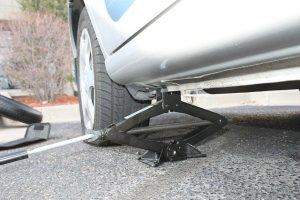Place jack under car close to flat tire